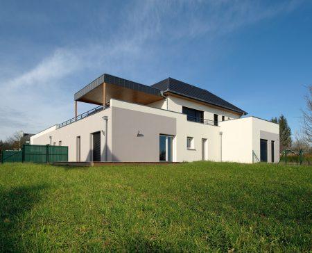 Construction collectif toiture à quatre pans - façade arrière et flanc